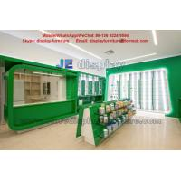 Quality Health drugs Store Display Furniture for Interior Design by Green color Wood  Cabinet and Tempered Glass Shelves wholesale