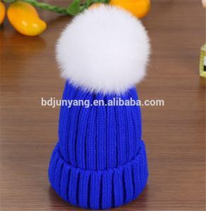 Quality women knit hat with fur poms wholesale