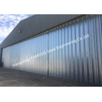 Quality Stable Triangular Seal Vertical Hinged Door Sectional Leaves Folding Sliding Hangar Doors wholesale