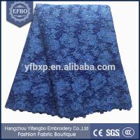 China Unique design floral embroidered tulle lace knitted patterns mesh fabric for clothing on sale