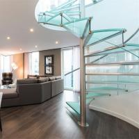 China Luxury Glass Tread Stainless Steel Railing Indoor Use Spiral Staircase on sale