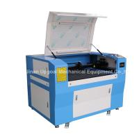 Quality Hot Sale Advertisement Co2 Laser Engraving Cutting Machine with 900*600mm Size wholesale