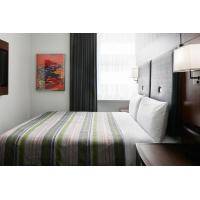 Cheap Hotel Bedroom Furniture Mahogany wood headboard Bed and Fixed Millwork TV Wall for sale
