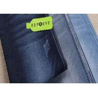 Quality unifi repreve denim fabric recycled material dark blue soft jeans fabric wholesale