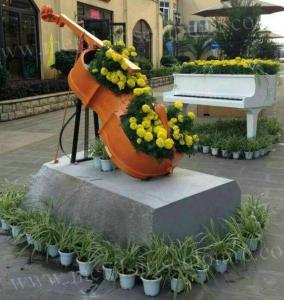 Quality Beautiful Fiberglass Resin Elegant Violoncello Statue For Outdoor School Decoration wholesale