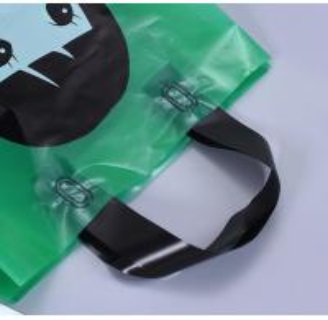 China soft loop plastic carry bags/soft plastic bags made in Vietnam,waterproof die cut handle plastic corn starch based biode on sale
