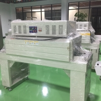 China Automatic Film Shrink Wrapping Machine Heat Tunnel Tube Wrap Packaging Machine on sale