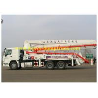 China SINOTRUK HOWO 37m concrete pump truck with 125 M3 / h 1370mm feeding height on sale