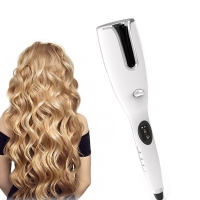 China 50W Auto Rotating Hair Curler Rotating Hair Curling Iron For Women on sale