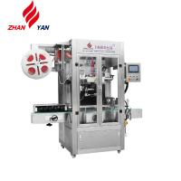 China Automatic Double Head Sleeve Label Inserting And Heat Shrink Packing Machine on sale